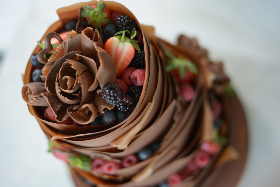Milk chocolate and berry wrapped three tier wedding cake to North Cornwall